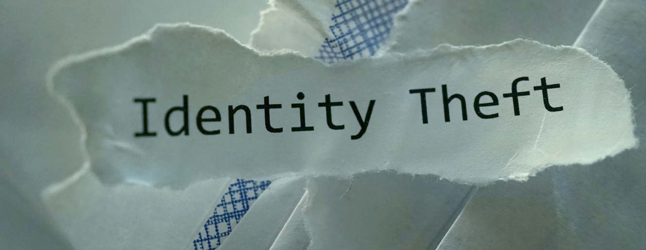 Identity Theft written on a piece of paper.