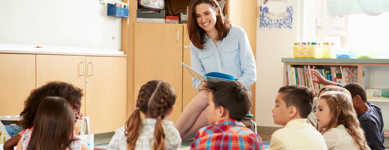 Teacher reading to young children.