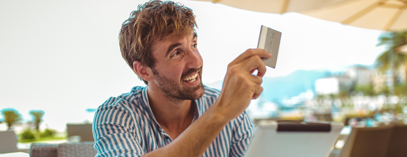 Man giving his credit card to pay for services.