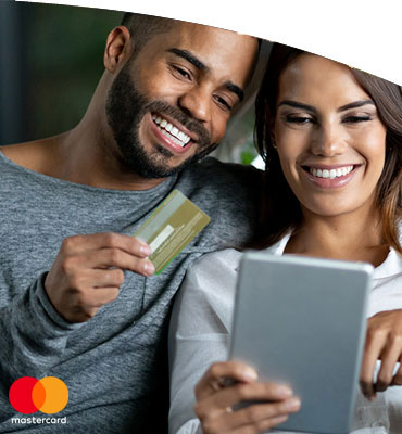 Man and woman holding a debit card and looking at an ipad