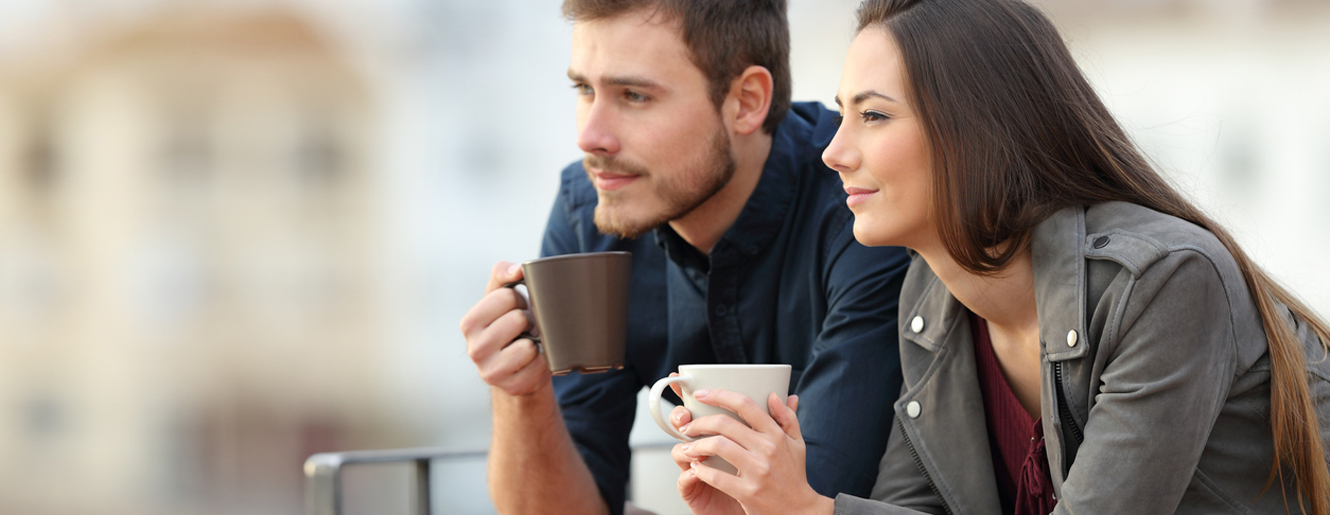 Couple drinking coffee.