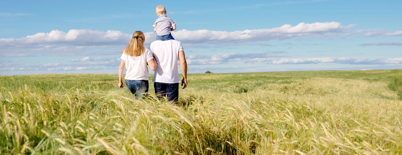 Family walking in tall grass