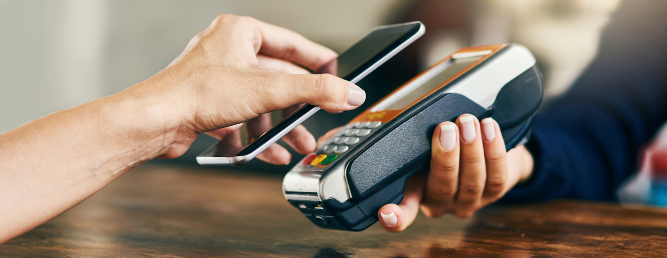 Using cell phone to pay a merchant
